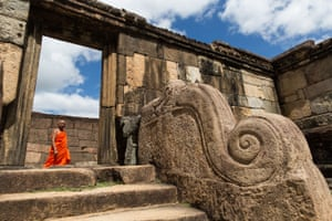 In the ruins of the ancient city of Poḷonnaruwa, built in the 12th century as Sri Lanka's second official capital, a nearly 1,000-year-old sculpture of an elephant forms part of an elaborate staircase