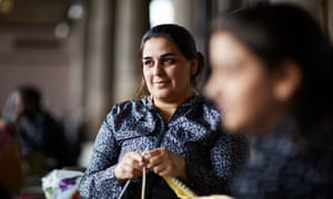 Asylum seeker Bakhtawer learning to knit at a British Red Cross drop-in session in Rochdale