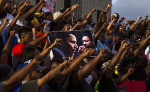 Demonstrators gather after marching at the Louisiana Capitol to protest at the death of Alton Sterling, who was shot by police on 5 July
