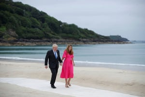 Boris Johnson and his wife Carrie on the beach at Carbis Bay, shortly before they posed for formal welcome photographs with all the leaders attending the summit.