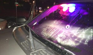 Bullet holes in one of two unmarked vehicles