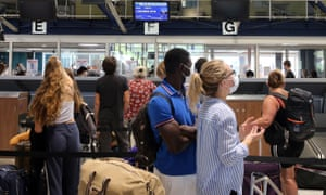 People check-in for a flight to London at Biarritz airport in France.