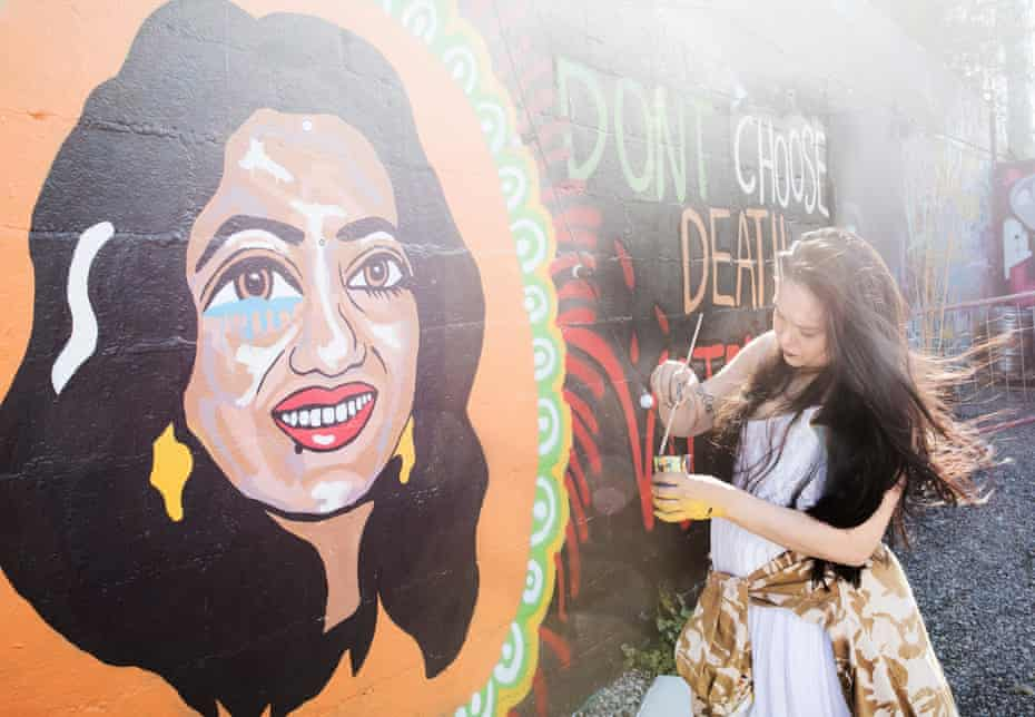 Graffitti artist Shirani Bolle paints an image of Savita Halappanavar, who died after doctors refused her an abortion in 2012