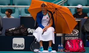 Ashleigh Barty takes shelter