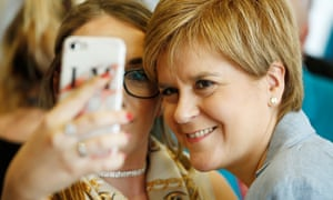 Nicola Sturgeon pauses for a selfie during a campaign visit to the Scottish Gas headquarters in Edinburgh.