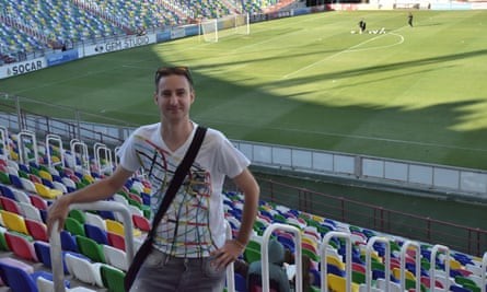 Matt Walker at the Mikheil Meskhi stadium in Tbilisi. He says: 'I got up last season's fixtures, hammered them into a spreadsheet and thought: Yes, it's just about doable.'