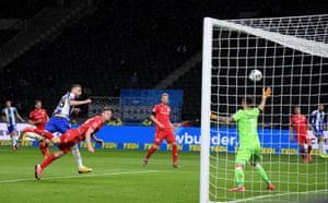 Hertha Berlin's Vedad Ibisevic thumps a header past goalkeeper Gikiewicz.