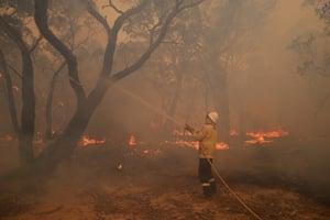 Firefighting crew fight a blaze near Braidwood, NSW.
