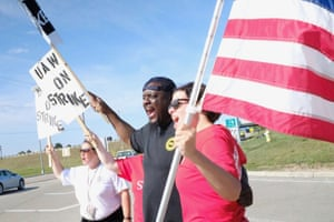 D'Andre Jackson, center, has worked for GM for 26 years and is a union representative.