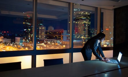 Woman looking at laptop on table at night