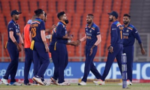India's Bhuvneshwar Kumar celebrates taking the wicket of England's Jos Buttler with teammates.