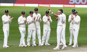 Stuart Broad celebrates taking his 500th test wicket with teammates against West Indies.