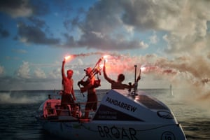 Three brothers from Scotland celebrate in Antigua after setting a world record by rowing across the Atlantic Ocean in 35 days