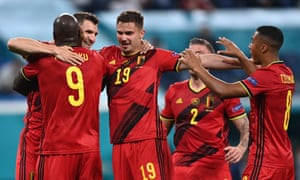 Thomas Meunier of Belgium (L) celebrates with teammates after scoring.