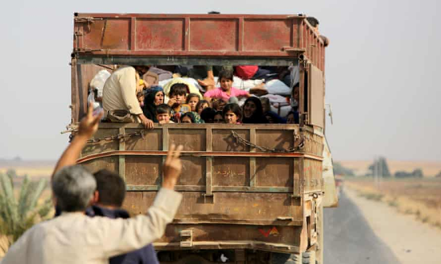 Kurdish Syrian civilians flee the town of Kobane on the Turkish border in October after the US declined to assist troops.