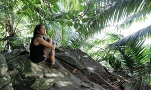 Marina watches the birds approach on Príncipe's coast