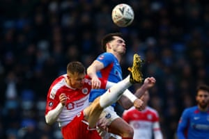 John Marquis of Portsmouth battles for the ball with Barnsley's Mads Andersen at Fratton Park in a goalfest which Portsmouth won 4-2.