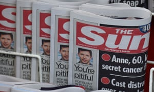 Copies of The Sun newspaper are seen on a newsstand outside a shop in central London 20 January 2015.