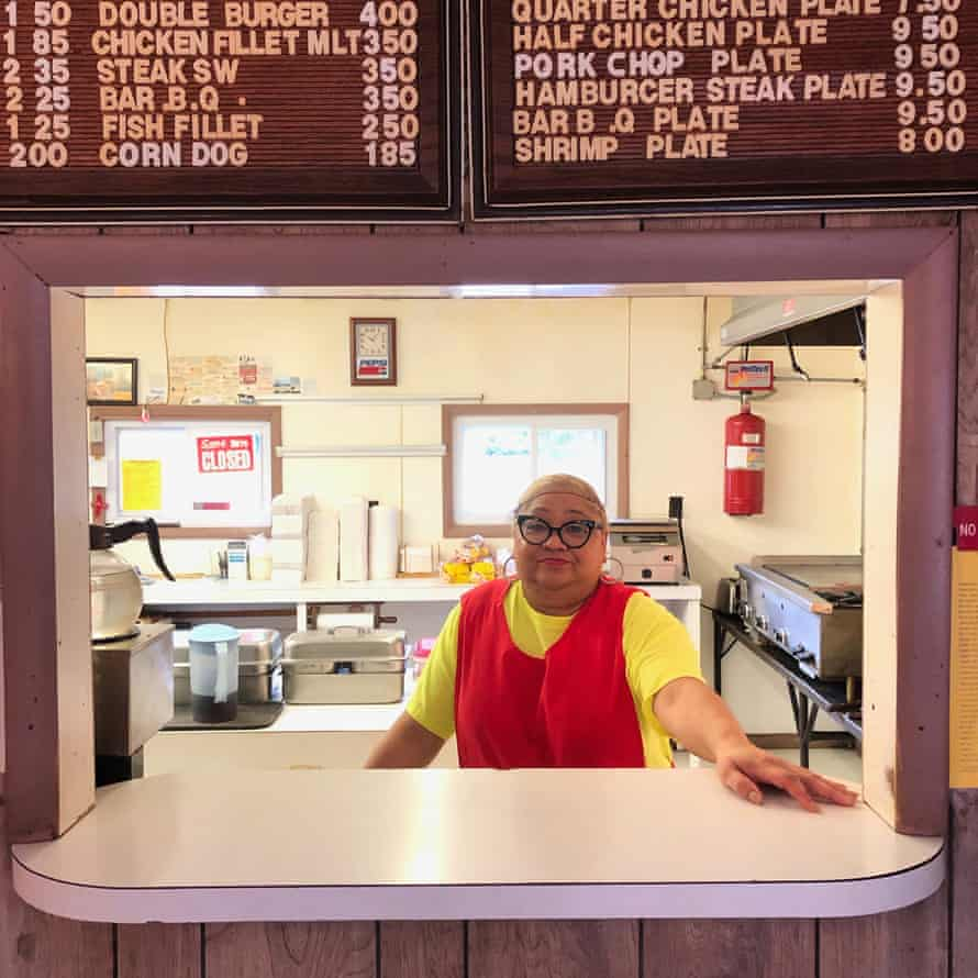 Longtime resident Bonnie Savage, whose home flooded twice in Hurricanes Matthew and Florence, behind the counter at Johnny's Drive-In on Main Street in Fair Bluff.