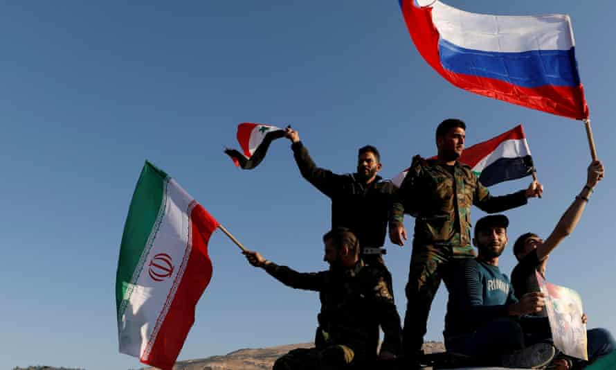 A group of Syrians wave flags