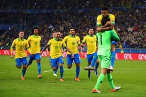 27 June 2019, Brazil v Paraguay, Arena do Gremio, Porto Alegre. Gabriel Jesus is congratulated by Alisson after scoring the winning penalty to win the game 4-3 for Brazil in the shoot out.