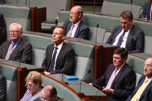Tony Abbott watches Opposition leader Bill Shorten deliver his Budget in reply speech in the House of Representatives, Parliament House Canberra this evening. Thursday 5th May 2016.