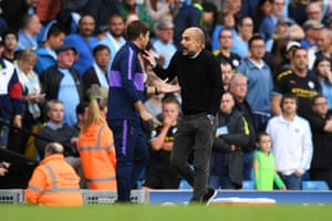 Mauricio Pochettino speaks with Pep Guardiola.