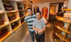 Wang Dan(L) and  Xu Yi at The Other Shore  funerary shop in Beijing, China