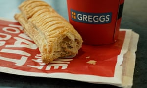A Greggs vegan sausage roll and drink cup