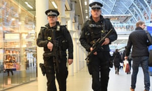Armed police officers patrol St Pancras International train