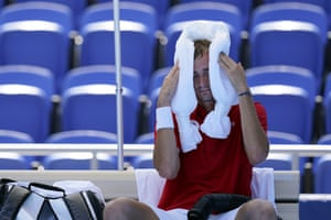 Daniil Medvedev attempts to cool off during a changeover in his victory over Alexander Bublik.