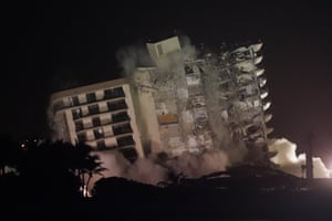 The damaged remaining structure at the Champlain Towers South condo building collapses in a controlled demolition in Surfside, Miami