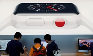 Customers are seen under a picture of Apple Watch Series 3 in Tokyo. You don't have to go to Japan to get it at a decent price today.