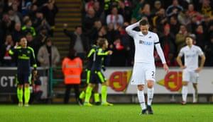 Gylfi Sigurdsson of Swansea City reacts to Arsenal's third goal.