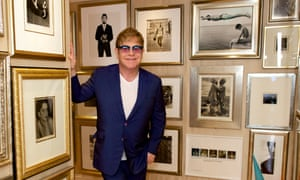 Elton John with his photography collection at home in west London.