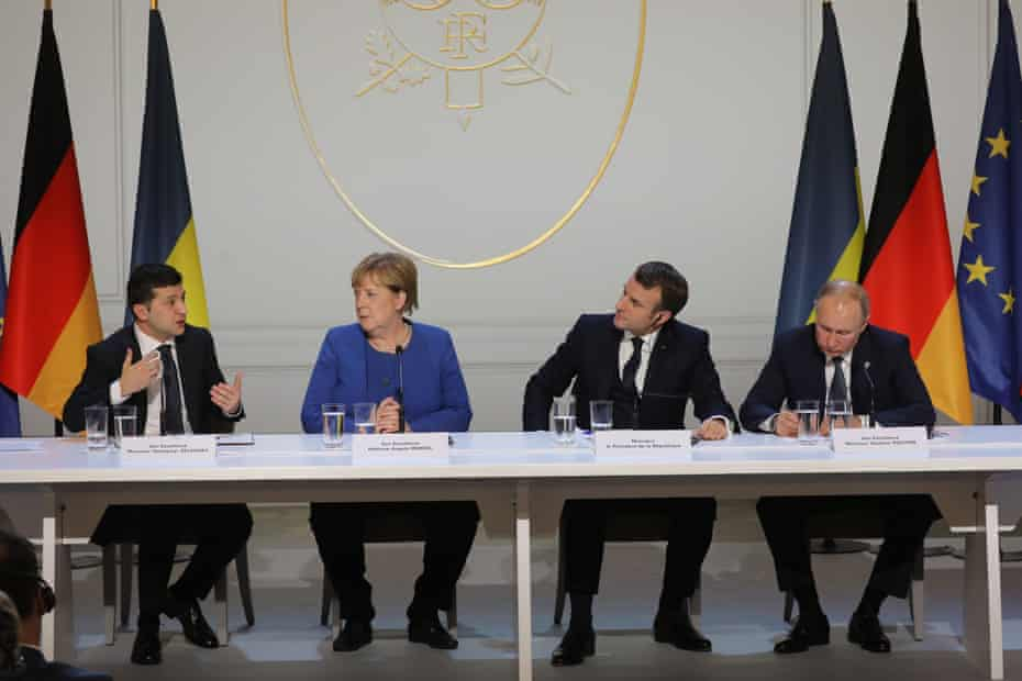 (FromL) Ukrainian President Volodymyr Zelensky, German Chancellor Angela Merkel, French President Emmanuel Macron and Russian President Vladimir Putin give a press conference after a summit on Ukraine at the Elysee Palace, in Paris, on December 9, 2019