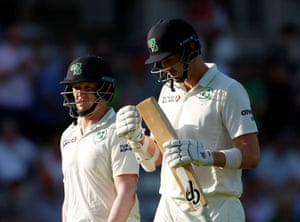 Ireland's Kevin O'Brien and Boyd Rankin walk off at the end of the Ireland innings.