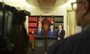 (L-R) Prime minister Scott Morrison, communications minister Paul Fletcher and treasurer Josh Frydenberg.