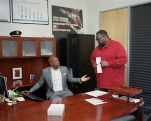 Joyner talks with Pastor Demetries Edwards, an executive member of the Ceasefire program, at the department's Eastmont Substation.