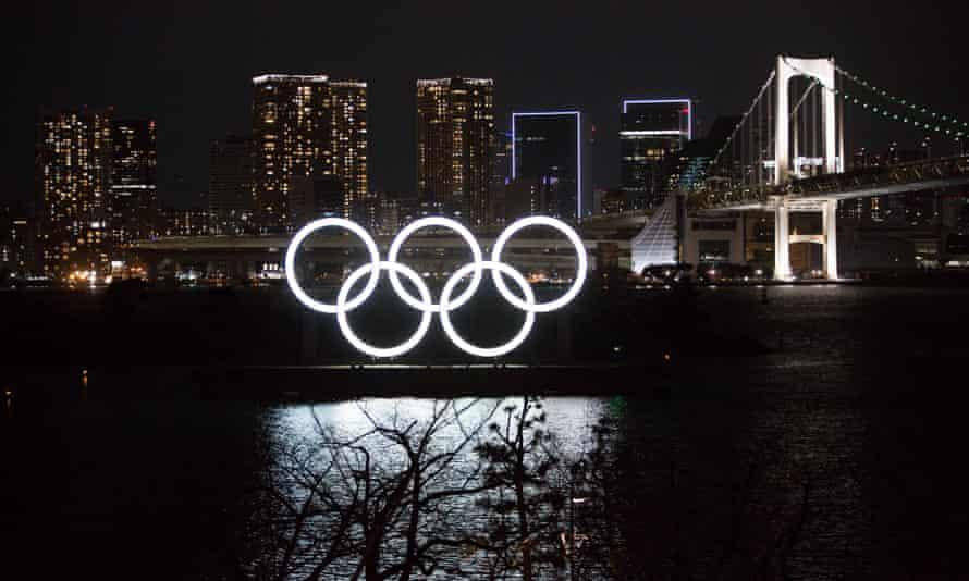 The illuminated Olympic Rings installation at Odaiba Marine Park in Tokyo.