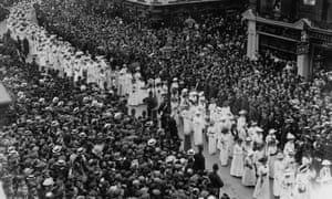 Crowds watch the funeral procession ofEmily Davison in 1913.