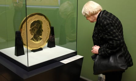 A visitor looks at the 100kg 'Big Maple Leaf' coin in the Bode museum.