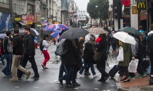 Shoppers sheltering from the rain in London's Tottenham Court Road