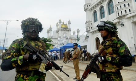 Troops outside a mosque in Colombo days after a series of bomb blasts targeted churches and luxury hotels on Easter Sunday