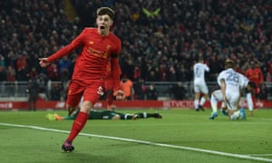 Ben Woodburn shows his delight after becoming Liverpool's youngest ever goalscorer with the second goal against Leeds.