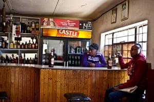 At a bar in Marija, a man sits drinking a morning beer