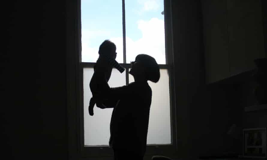 Silhouette of a mother and baby