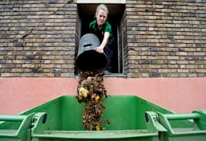 Gemma Metcalf tips hippo excrement into bins