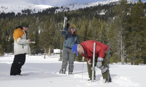 Frank Gehrke, right, chief of the California Cooperative Snow Surveys Program for the department of water resources, checks the snowpack depth near Echo Summit in the Sierra Nevada.