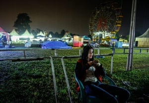 Karmila Purba, 18, waits for her performance at the 'Tong Setan', or Devil's Barrel, at a night carnival in Deliserdang, Indonesia